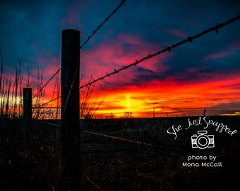 Sunrise through a Kansas Fence