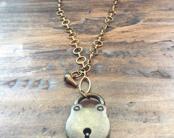Vintage style padlock and bird charm necklace