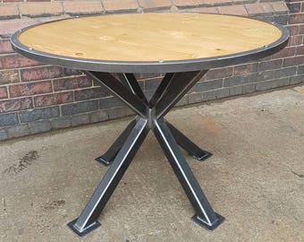 Vintage industrial style round table. Metal pedestal frame. Circular urban industrial table. Industrial chic.