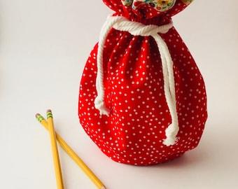 Large red polka dot drawstring bag