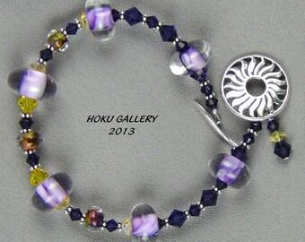 "Purple Lampwork Glass Beads, Purple, Orange, Yellow Seeds, Swarovski Crystals, Bali Beads, Sterling Silver Toggle Clasp - Bracelet - 7"""