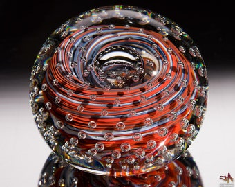 Handcrafted Art Glass Paperweight - Red and White Color Streaks with Bubble Grid