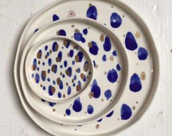 Blue and gold splodgey porcelain dish