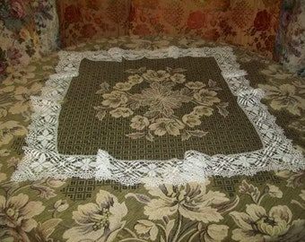 A beautiful old circled with product made bobbin lace.  Never used