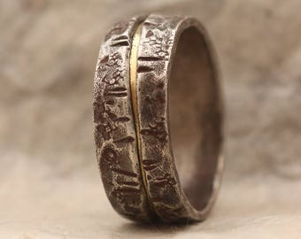 Mans wedding ring of sterling silver and 18k gold hammered and distressed with rustic features.