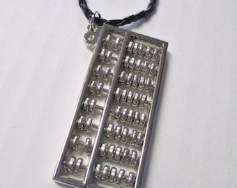 ABACUS Jumbo Silvertone Pendant Necklace on Black Faux Leather Braided Cord