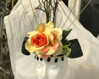 large yellow and orange rose with two black axes headband headdress