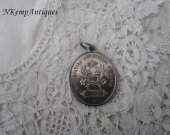 Antique religious medal