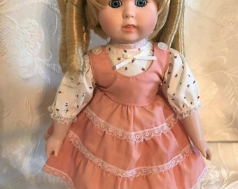 "Dynasty Collectible baby girl Doll with blue eyes and blonde ringlets, 14"" tall"