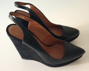 Black leather shoes with suede wedge