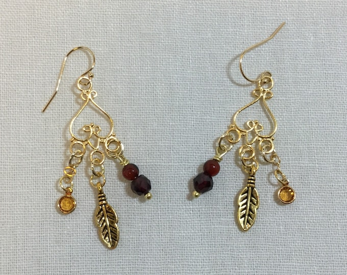 Gold chandelier earrings with carnelian, quartz, topaz crystal and feather