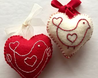 Hand embroidered hanging heart decorations with love bird