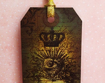 "Brand green pages ""Curiosities"" flaming eye, Crown and key"