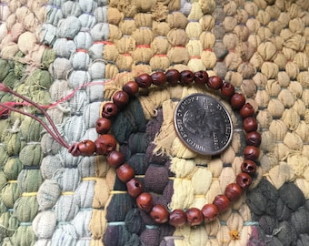 Petite 5x6mm wood skull bead mala bracelet strand with guru bead