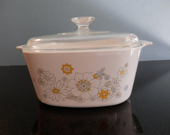 Corning Ware casserole with Pyrex lid in a flower pattern