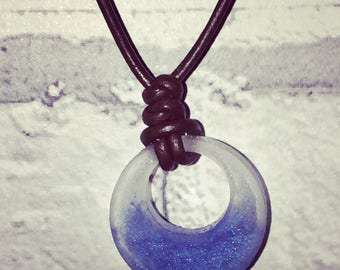 Two toned resin pendant with leather necklace.