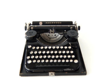 Vintage Underwood Portable Universal typewriter. Made in the USA 1930tees.