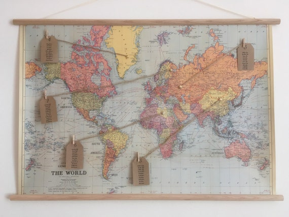 Vintage world map wedding seating plan with wooden dowels and publicscrutiny Image collections