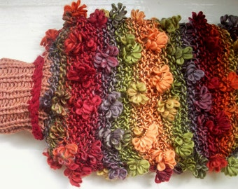 Fun hand knitted hot water bottle and cozy cover large soft warm orange red green Autumn flowers