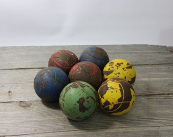 Set of 7 vintage metal bocce or petanque balls, colorful iron lawn bowling balls. Great decorative balls. Petanque, bocce, metal balls