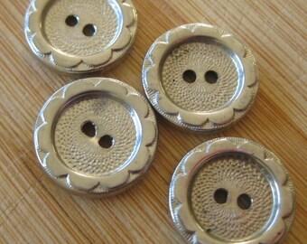 Four vintage silver metal buttons