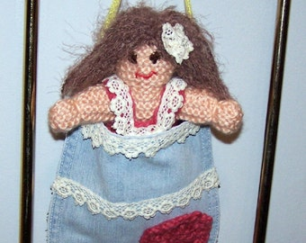 Knit doll in a recycled denim pocket
