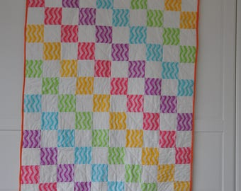 Pattern to make rainbow baby quilt/play mat. Option for five fat quaters. Also includes bonus cushion pattern.