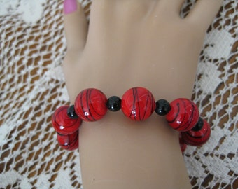 Glass beaded stretch bracelet, Red and black beaded bracelet