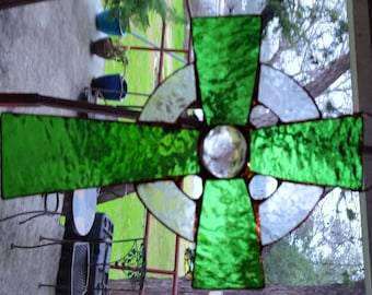 Green and clear glue chip stained glass cross with glass marble center. Sun-catcher