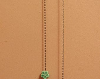 A necklace with knotted balls