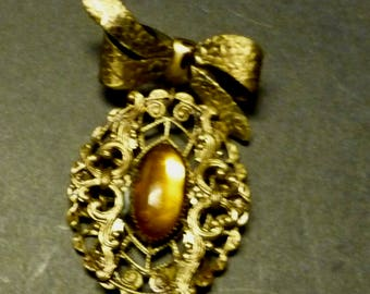 Amber Stone Pendant with Bow gold medal brooch