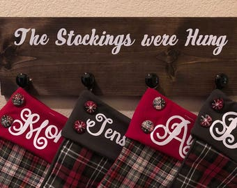 Stockings holder, Christmas sign, and the stockings were hung