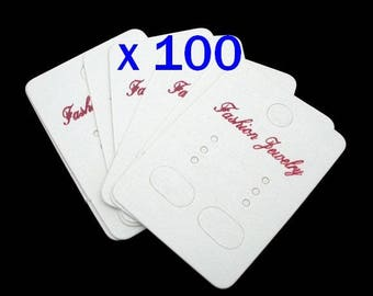 set of 100 medium white display board is pre-drilled for earrings