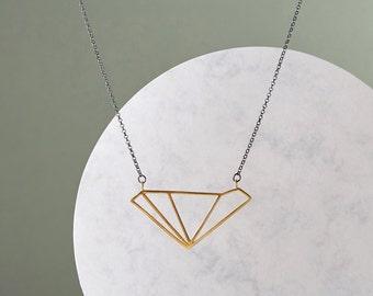 Gold-plated asymmetric diamond pendant on oxidised silver chain