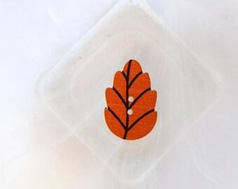 Orange leaf button