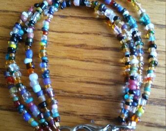 multi color 4 strand beaded bracelet