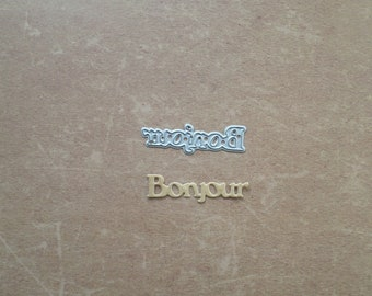 Die cut matrix Bonjour French word Metal