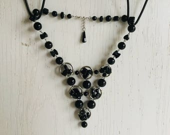Black bib necklace with silver color rings