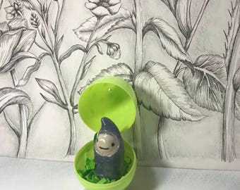 Blue sprite in a green easter egg, fairy garden sprite