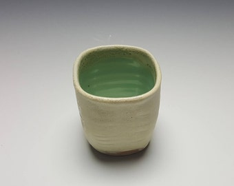 Ceramic tumbler by Potteryi. Squared tumbler in cream and celadon.