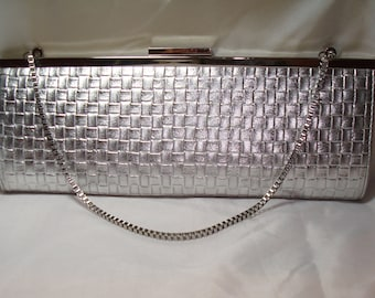 1995 Long and Slender Silver Clutch and Handbag.