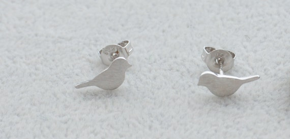 Pair Of Little Bird Stud Earrings In Sterling Silver Textured. Catholic Medallion. Scorpio Pendant Medallion. Award Seal Medallion. Lucy Williams Medallion. Gold Chain Medallion. Secret Paths Medallion. Seiko 4402 Medallion. Award Winning Medallion