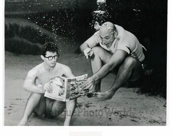 Two men under water reading art photo by B. Mozert