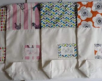 Large beige bread bag and cotton print/DrawString bag for storing bread.