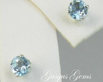 Sky Blue Topaz 4mm .65ctw Sterling Silver Stud Earrings