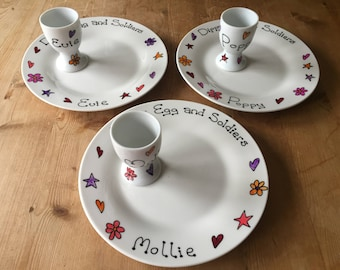 Hand painted personalised plate and egg cup
