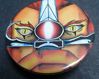 Thundercats badge or fridge magnet -- 38 mm -- Liono -- Sword -- 80s -- Cartoon -- Cult TV -- Pin back button