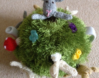 Hand knitted rabbit tea cosy