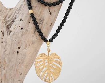 Long Bohemian chic beaded black and gold or silver with exotic Leaf Philodendron (SAUT22) pendant