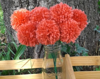 12 Coral yarn pom pom flowers. Pom pom bouquet centerpieces. Wedding/ baby shower decorations. Home decor.